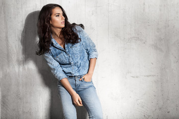 Latin woman in jeans and a denim shirt