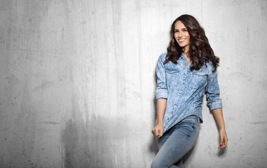 Smiling girl in denim with curly hair