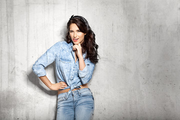 Smiling winking girl in jeans