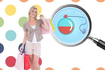 Composite image of happy blonde with shopping bags