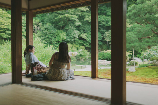 Women enjoying Japanese garden