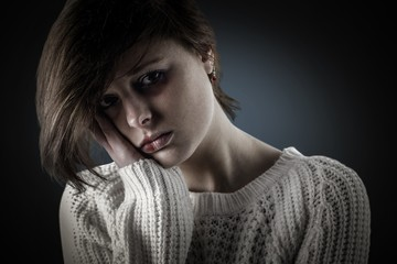 Composite image of pretty brunette feeling sad