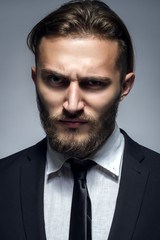 Handsome Man With Beard In Black Suit