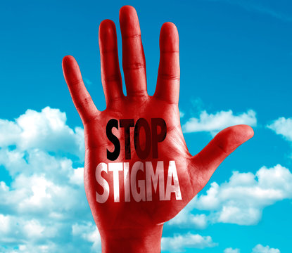 Stop Stigma written on hand with sky background