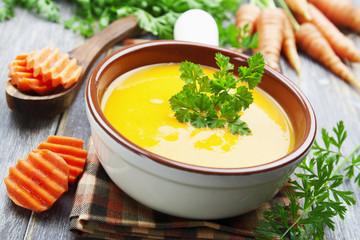 Carrots soup in the ceramic pot