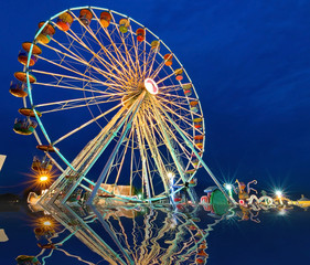 Ferris wheel with outdoor long exposure at reflect twilight.