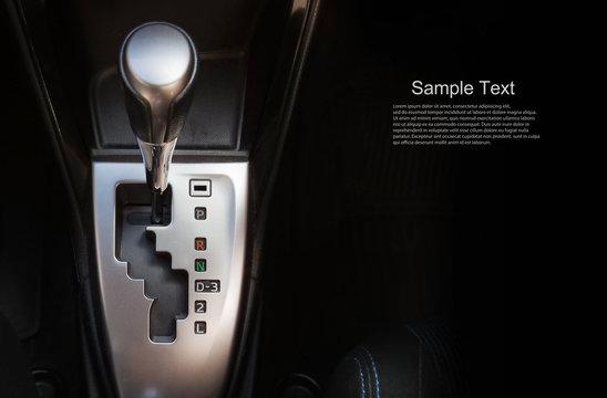 Close up gear stick interior inside bright car.