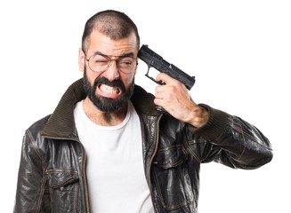 Man wearing a leather jacket cometing suicide