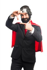 Super hero businessman focusing with his fingers