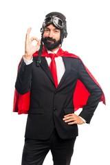 Super hero businessman making OK sign