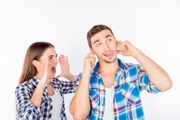 Stressed young woman shouting at her boyfriend