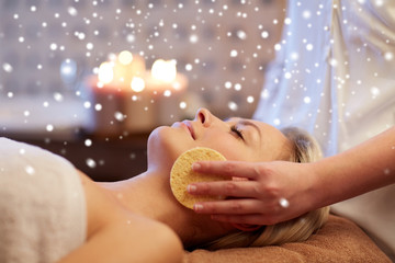 close up of woman having face massage in spa salon