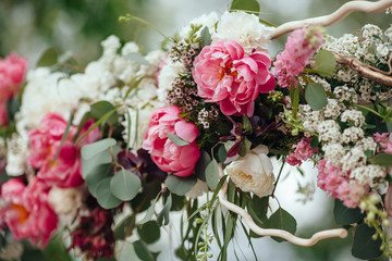 archway of many beautifil flowers, wedding arch with peones