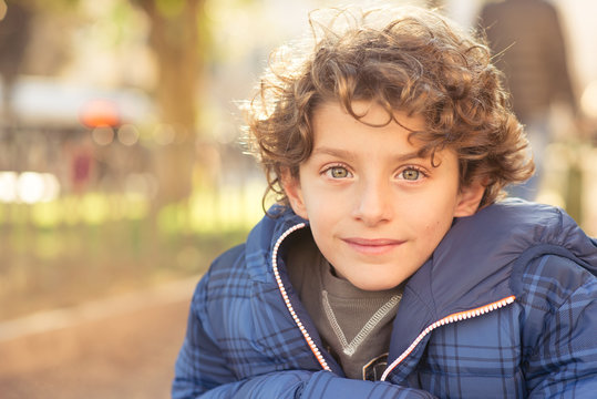 Portrait of young boy, winter dressed and looking at the camera.