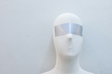 Puppet blindfolded with tape