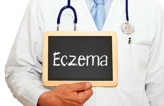 Eczema - Doctor holding chalkboard with text on white background