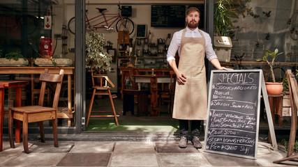Barista standing in the doorway of a restaurant