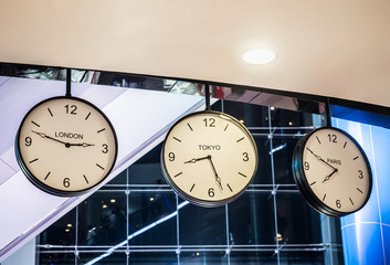 Three differnt international hanging wall clock, London, Tokyo,
