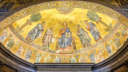 The icon on the dome with the image of Jesus Christ and the Apostles on a gold background in the catholic church cathedral basilica of Saint Paul in Rome, Italy