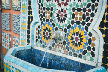Wonderful Moroccan street drinking fountain with traditional tile mosaic pattern