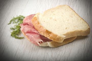 sandwich with Italian prosciutto crudo ,raw ham leg sliced