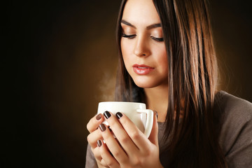 Portrait of pretty woman with cup of coffee, close up