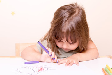 small girl painting with felt pen