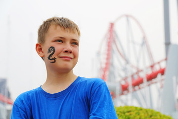 Portrait of a boy at an amusement park
