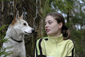 Double portrait of the beauty girl and husky dog