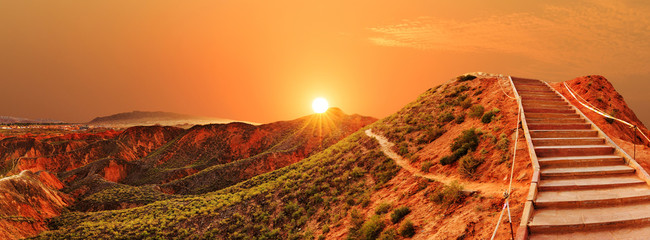 Photo sur Plexiglas Orange eclat sunrise,sunset skyline, paved step road and landscape of red san