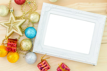 Vintage white blank photo frame with christmas decorations on wo