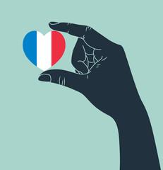 hand holding heart shape France flag