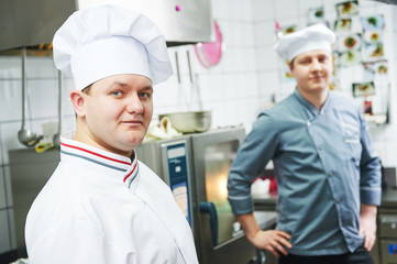 Two chef cook at kitchen