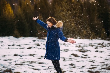 Beautiful Young Smiling Girl in her Winter Warm Clothing