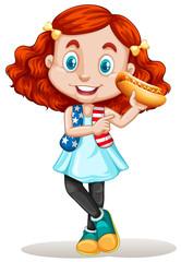 Little girl eating hotdog