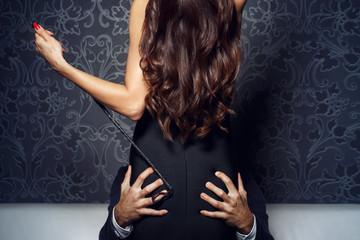 Rich businessman grip woman ass at night