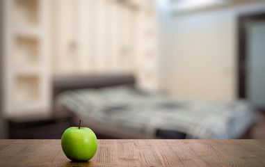 green apple old wooden table