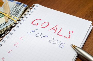 GOALS for 2016 message with 100 US dollars and pen