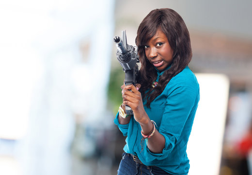 black woman joking with a gun
