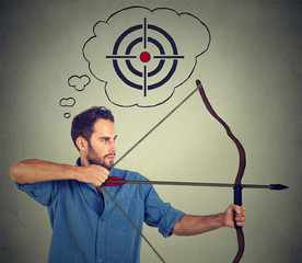 Concept of determinate business man with bow and arrow.