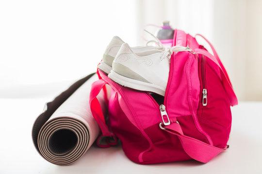 close up of female sports stuff in bag