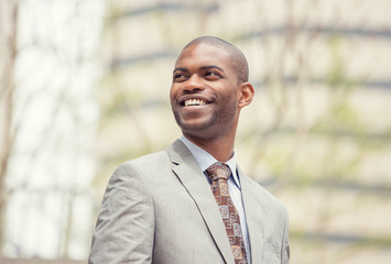 Headshot portrait of young professional man smiling laughing