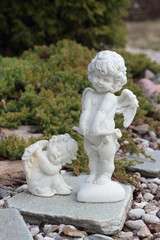 Two Figure of Cupid on a stones