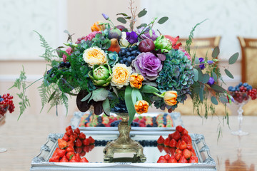 Serving on the table restaurant catering elegant floral arrangement wedding