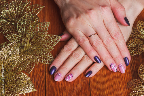 Winter Nail Art With Purple And Pink Colors Stock Photo And Royalty