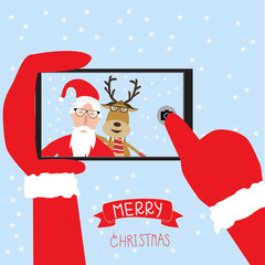 Hipster santa claus and reindeer selfie with smartphone for merr