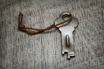 Old small key on the table
