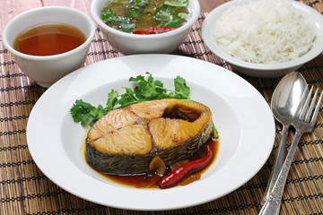 com ca thu kho, rice with king mackerel simmered in caramelized sauce, vietnamese cuisine