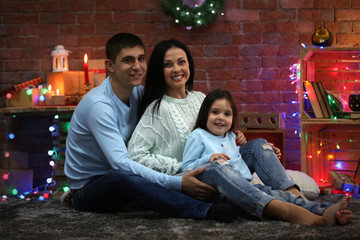 Happy family in the decorated Christmas room