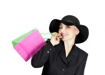 Happy lady in a business suit and hat with a brown paper bag, isolated on white background